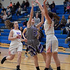 Ashley Buttolph of Keystone finds her shot denied by Maeve Johnston of Bay. Jen Forbus -- The Morning Journal