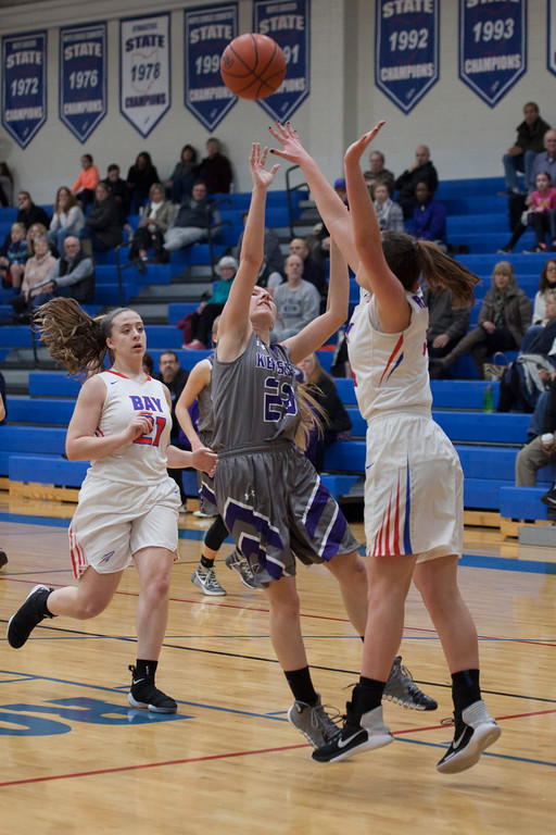 . Ashley Buttolph of Keystone finds her shot denied by Maeve Johnston of Bay. Jen Forbus -- The Morning Journal