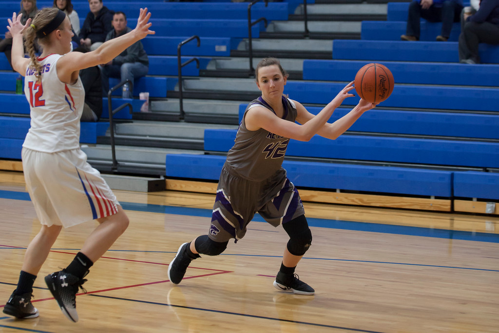 . Keystone\'s Grace Baracskai has to find a way around Bay\'s Maddie Edgerly.  Jen Forbus -- The Morning Journal