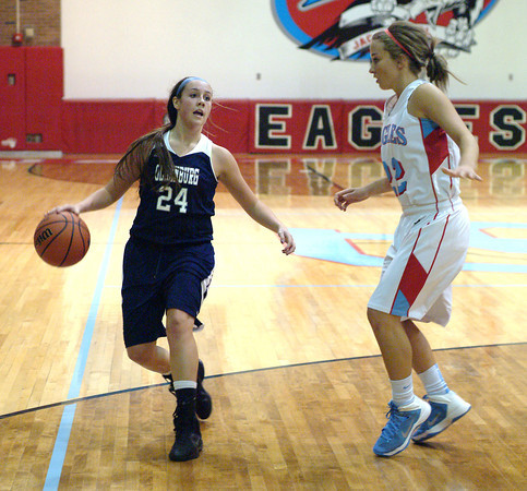 Staff photo by Bryan Helvie<br /> On the break: Oldenburg Academy's Briana Tindall is being defended by Jac-Cen-Del senior Sydney Keene in the first half Friday night in Osgood.