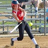 Liv James hits for a double Tuesday against Columbia at Wellington Community Park. JESSE GRABOWSKI / CHRONICLE