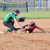 Columbia's Jill Grzywna misses the tag on Firelands' Liv James Tuesday. JESSE GRABOWSKI / CHRONICLE