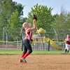 Emma James catches an easy fly ball Tuesday at Wellington Community Park. JESSE GRABOWSKI / CHRONICLE