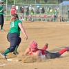 Hailey Blankenship slides back into 3rd to avoid the out Tuesday at Wellington Community Park. JESSE GRABOWSKI / CHRONICLE