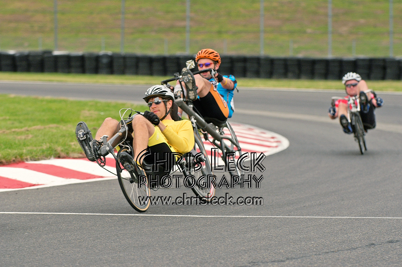 Michael Wolfe (l) chased by Chris Sandmel through the curves. Road race, unfaired divisions. Oregon Human Powered Vehicles 6th Annual Human Power Challenge, May 29, 2005, Portland International Raceway.
