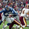 LANDOVER, MD - DECEMBER 3: Defensive End Michael Strahan #92 of the New York Giants broke through the Washington Redskins' line in an attempt to sack Quaterback Brad Johnson #14 in a NFL game against the Washington Redskins at FedExField on December 3, 2000 in Landover, Maryland. The Redskins won 9 to 7. (Photo by Michael J. Minardi) *** Local Caption *** Michael Strahan;Brad Johnson