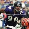 BALTIMORE, MD - SEPTEMBER 24: Defensive End Michael McCrary #99 of the Baltimore Ravens runs in to assist teammate Defensive Tackle Sam Adams #95 in the tackle of Halfback Corey Dillon of the Cincinnati Bengals during a NFL game at PSINet Stadium on September 24, 2000 in Baltimore, Maryland. The Ravens won the game 37-0. (Photo by Michael J. Minardi) *** Local Caption *** Michael McCrary;Sam Adams