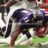 BALTIMORE, MD - SEPTEMBER 24: Running Back Jamal Lewis #31 of the Baltimore Ravens carries the ball for some good yardage until he his tackled by Linebacker Takeo Spikes #51 and Defensive End John Copeland #92 of the Cincinnati Bengals during a NFL game at PSINET Stadium on September 24, 2000 in Baltimore, Maryland. The Ravens won 37-0. (Photo bt Michael J. Minardi) *** Local Caption*** Jamal Lewis;John Copeland;Michael Bankston;Cory Hall