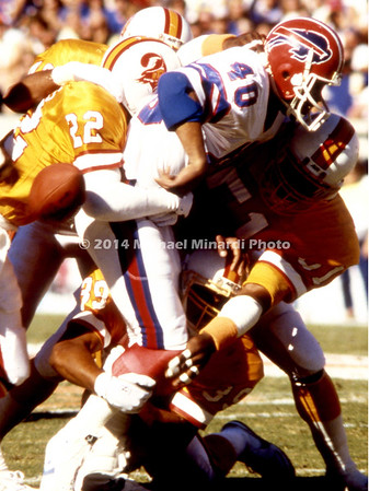 TAMPA, FL - DECEMBER 4: Running Back Robb Riddick #40 of the Buffalo Bills fumbles the football while being tackled by Rod Jones #22 of the Tampa bay Buccaneers. Tampa won 10 to 5. (Photo by Michael Minardi) *** Local Caption ***Robb Riddick;Rod Jones