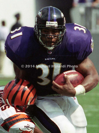 BALTIMORE, MD - SEPTEMBER 24: Running back Jamal Lewis #31 of the Baltimore Ravens carries the ball for several yards with the help of the blocking of his Lineman Edwin Mulitalo #64 while Corner back Artrell Hawkins #27 of the Cincinnati Bengals attempts a tackle in a NFL game against the Cincinnati Bengals at PSINet Stadium on September 24, 2000 in Baltimore, Maryland. The Ravens won the game 37-0. (Photo by Michael J. Minardi) *** Local Caption *** Jamal Lewis;Edwin Mulitalo;Artrell Hawkins