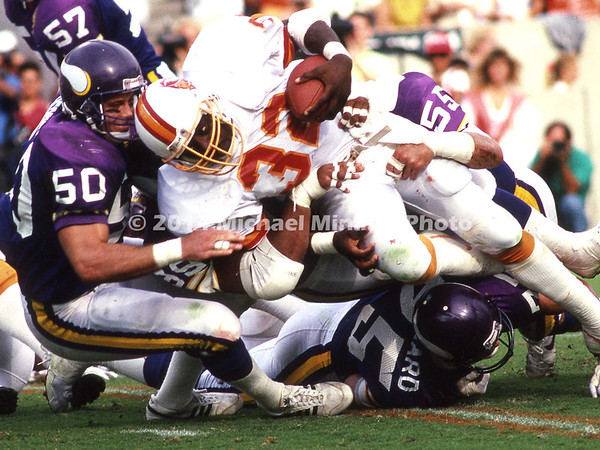 TAMPA, FL - NOVEMBER 12: Running Back James Wilder #32 of the Tampa Bay Buccaneers is brought down by Right Line Backer Ray Berry #50 of the Minnesota Vikings during a NFL game on November 12, 1989 at Tampa Stadium in Tampa, Florida. Minnesota won 24 - 10. (Photo by Michael Minardi) *** Local Caption *** James Wilder;Ray Berry