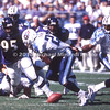 BALTIMORE, MD - OCTOBER 22:Defensive Tackle Sam Adams #95 of the Baltimore Ravens went after the ball when Runningback Rodney Thomas #22 of the Tennessee Titans fumbled the handoff from the Titans' Quarterback Steve McNair #9 in a NFL game at PSINet Ravens Stadium on October 22, 2000 in Baltimore, Maryland. The Titans won 14 to 6 against the Ravens. (Photo by Michael J. Minardi) *** Local Caption *** Sam Adams;Rodney Thomas;Steve McNair