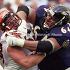 BALTIMORE, MD - SEPTEMBER 24: Offensive lineman Edwin Mulitalo #64 of the Baltimore Ravens puts a good block on Linebacker Steve Foley #95 of the Cincinnati Bengals during a NFL game at PSINet Stadium on September 24, 2000 in Baltimore, Maryland. The Ravens won the game 37-0. (Photo by Michael J. Minardi) *** Local Caption *** Edwin Mulitalo;Steve Foley