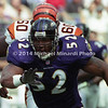 BALTIMORE, MD - SEPTEMBER 24: Line backer Ray Lewis #52 of the Baltimore Ravens moves closer to his opposition in order to tackle Half back Corey Dillon #28 of the Cincinnati Bengals who is carrying the ball for a few extra yards during a NFL game at PSINet Stadium on September 24, 2000 in Baltimore, Mayland. (Photo by Michael J. Minardi) *** Local Caption *** Ray Lewis;Corey Dillon