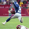 BALTIMORE, MD - DECEMBER 3: Corner Back Emmanuel McDaniel #26 of the New York Giants intercepted a pass and ran downfield and  leaped over Running Back Stephen Davis #48 of the Washington Redskins for yardage in a NFL game at FedEx Field on December 3, 2000 in Landover, Maryland. The Giants won over the Redskins 9 to 7. (Photo by Michael J. Minardi) *** Local Caption *** Emmanuel McDaniel;Stephen Davis