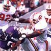 TAMPA, FL - NOVEMBER 12; Running Back Herschel Walker #34 of the Minnesota Vikings makes a first down against the Tampa Bay Buccaneers on November 11, 1989 in Tampa Stadium in Tampa, Florida. He was tackled by DB Ricky Reynolds #29 and LB Erwin Randle #54 of Tampa Bay. The Vikings defeated the Bucs 24-10. (Photo by Michael Minardi) ***Local Caption ***Herschel Walker; Ricky Reynolds; Erwin Randle
