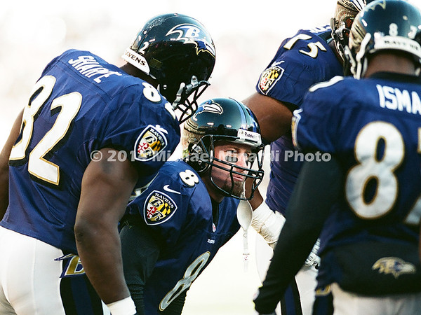 BALTIMORE, MD - DECEMBER 24; Trent Dilfer Quarterback #8 of the Baltimore Ravens calls the next play in the huddle against the New York Jets at PSINet Ravens stadium on December 24, 2000 in Baltimore, Maryland. The Ravens defeated the Jets 34 to 20 and went on to win the Super Bowl that season. (Photo by Michael Minardi) ***Local Caption*** Trent Dilfer