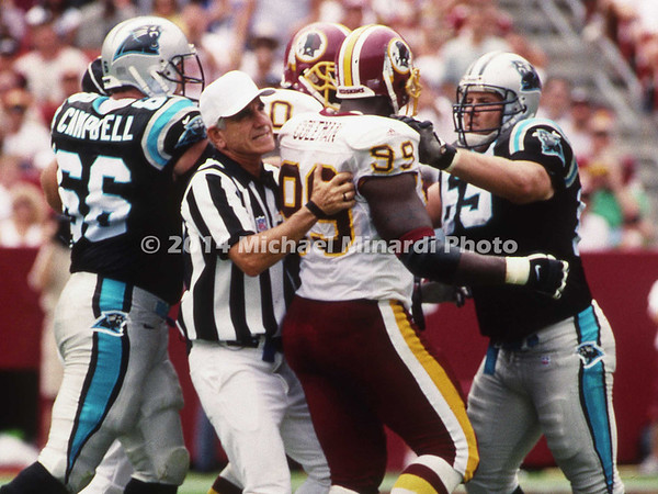 LANDOVER, MD - SEPTEMBER 3: Center Frank Garcia #65 of the Carolina Panthers gets into a pushing match with Defensive End Marco Coleman #99 of the Washington Redskins during a NFL game at FedEx Field on September 3, 2000 in Landover, Maryland. The Redskins defeated the Panthers 20-17. (Photo by Michael J. Minardi) *** Local Caption *** Frank Garcia;Marco Coleman