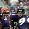 BALTIMORE, MD - SEPTEMBER 24: Half back Corey Dillon #28 of the Cincinnati Bengals carries the ball for some yardage in between Baltimore Ravens players Defensive Tackle Lional Dalton #91 and Defensive End Michael McCrary #99 and Defensive End Rob Burnett #90 during a NFL game at PSINet Stadium on September 24, 2000 in Baltimore, Maryland. The Ravens won 37-0. (Photo by Michael J. Minardi) *** Local Caption *** Corey Dillon;Lional Dalton;Rob Burnett;Michael McCrary