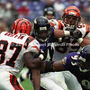 BALTIMORE, MD - SEPTEMBER 24: Defensive End Keith Washington #93 and Safety Anthony Mitchell #42 both of the Baltimore Ravens grab Wide Receiver Damon Griffin #87 of the Cincinnati Bengals who is carrying the ball while getting blocking from teammate Tight End Marco Battaglia during a NFL game at PSINet Stadium on September 24, 2000 in Baltimore, Maryland. The Ravens won 37-0. (Photo by Michael J. Minardi) *** Local Caption *** Keith Washington;Anthony Mitchell;Damon Griffin;Marco Battaglia