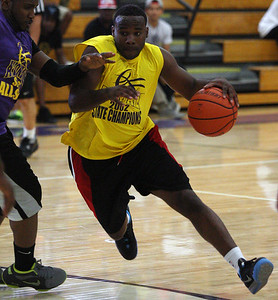 Former Avondale Basketball player and 2002 state championship team member Kerry Cole drives toward the basket during a game against a team of Avondale all-stars past and present Friday, June 27, 2014. (Special to The Oakland Press/LARRY McKEE)