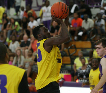 Former Avondale point guard and 2002 state championship team member Dave Holston goes up for a shot during a game against a team of Avondale all-stars past and present Friday, June 27, 2014. (Special to The Oakland Press/LARRY McKEE)