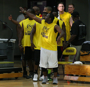 The Avondale Yellowjacket 2002 state championship basketball team reunited to play a basketball game against past and present Avondale all-stars Friday, June 27, 2014. Here former 2002 team members wave to the crowd before entering the court. (Special to The Oakland Press/LARRY McKEE)