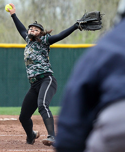 Sierra Gonzales, Lake Orion, delivers a pitch during varsity softball action against Clarkston at Lake Orion High School Thursday, May 15, 2014. (Special to The Oakland Press / LARRY McKEE)