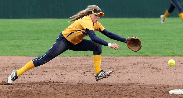 Rachel Vieira, Clarkston, attempts to run down a ground ball during varsity softball action at Lake Orion High School Thursday, May 15, 2014. (Special to The Oakland Press / LARRY McKEE)