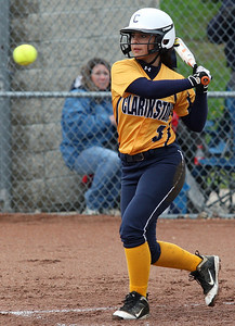 Rachel Alli, Clarkston, zeros in on a pitch during varsity softball action at Lake Orion High School Thursday, May 15, 2014. (Special to The Oakland Press / LARRY McKEE)3