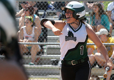 Alexandra Carpenter, Lake Orion, celebrates after scoring a run during district softball action against Clarkston at Lake Orion High School Saturday, May 31, 2014. (Special to The Oakland Press / LARRY McKEE)