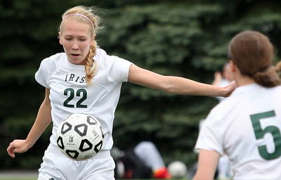 Taylor Timko (22), Pontiac Notre Dame Prep, makes a play at midfield during girls varsity soccer action against Farmington Hills Mercy at Prep Friday, May 9, 2014. (Special to The Oakland Press / LARRY McKEE)