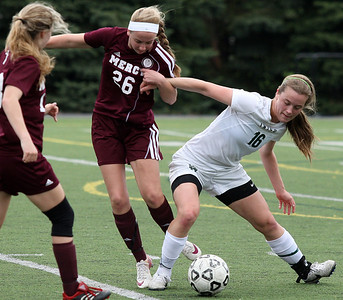 Lindsey Klei (16), Pontiac Notre Dame Prep, battles for ball possession with Zoe Menard (26), Farmington Hills Mercy, during girls varsity soccer action at Prep Friday, May 9, 2014. (Special to The Oakland Press / LARRY McKEE)