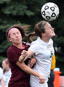 Hannah Zapczynski (5), Pontiac Notre Dame Prep, goes up for a header in front of Alexandra Griffin, Farmington Hills Mercy, during girls varsity soccer action at Prep Friday, May 9, 2014. (Special to The Oakland Press / LARRY McKEE)