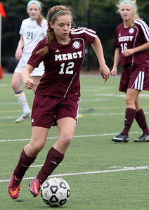 Allia McDowell (12),Farmington Hills Mercy, brings the ball up field during girls varsity soccer action at Pontiac Notre Dame Prep Friday, May 9, 2014. (Special to The Oakland Press / LARRY McKEE)