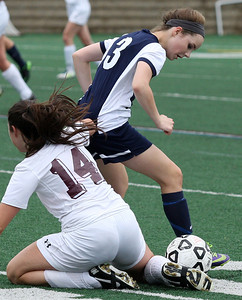Ashley Grove (13), Farmington, dribbles past Katie Powell, Birmingham Seaholm, during girls varsity soccer action at Seaholm Tuesday, May 13, 2014. (Special to The Oakland Press / LARRY McKEE)