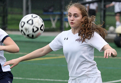 Abby Mancuso, Birmingham Seaholm, steps in front of a pass during girls varsity soccer action against Farmington at Seaholm Tuesday, May 13, 2014. (Special to The Oakland Press / LARRY McKEE)