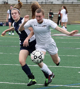 Jen Kendall (right), Birmingham Seaholm, collides with Jessica Clappison, Farmington, during girls varsity soccer action at Seaholm Tuesday, May 13, 2014. (Special to The Oakland Press / LARRY McKEE)