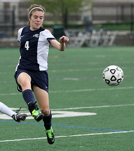 Jessica Clappison, Farmington, kicks the ball upfield during girls varsity soccer action at Birmingham Seaholm Tuesday, May 13, 2014. (Special to The Oakland Press / LARRY McKEE)