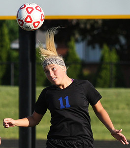 Anna Robb, Lakes Collegiate, makes a header pass during regional final action against Cardinal Mooney Catholic at Madison Heights Bishop Foley High School Friday, June 6, 2014. (Special to The Oakland Press / LARRY McKEE)