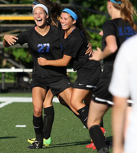 Lindsay Straw (center), Lakes-Collegiate, celebrates scoring a goal with Gabby Troy (27), during regional final action against Cardinal Mooney Catholic at Madison Heights Bishop Foley High School Friday, June 6, 2014. (Special to The Oakland Press / LARRY McKEE)