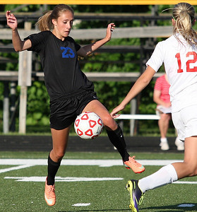 Allison Maiorana, Lakes-Collegiate, brings the ball upfield during regional final action against Cardinal Mooney Catholic at Madison Heights Bishop Foley High School Friday, June 6, 2014. (Special to The Oakland Press / LARRY McKEE)