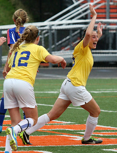 Julia Griessmann (9), Birmingham Marian, celebrates with teammate Ellie Deconinck (12), after scoring a goal during Division 2 semifinal soccer action against Livonia Ladywood at Fenton High School Wednesday, June 11, 2014. Marian defeated Ladywood 3-1 and will now move to the Division 2 championship game this Saturday in Lansing. (Special to The Oakland Press / LARRY McKEE)