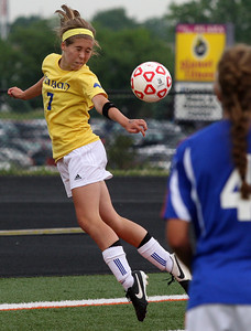 Hannah Redoute, Birmingham Marian, makes a header pass during Division 2 semifinal soccer action against Livonia Ladywood at Fenton High School Wednesday, June 11, 2014. (Special to The Oakland Press / LARRY McKEE)