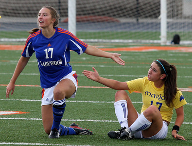 Jaclyn Engel (17), Birmingham Marian and Samantha Riga, Livonia Ladywood, plead their case to an official during Division 2 semifinal soccer action against Livonia Ladywood at Fenton High School Wednesday, June 11, 2014. (Special to The Oakland Press / LARRY McKEE)