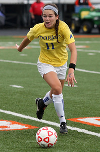Kelly Sweeney, Birmingham Marian, brings the ball upfield during Division 2 semifinal soccer action against Livonia Ladywood at Fenton High School Wednesday, June 11, 2014. Sweeny contributed two goals in the Mustangs 3-1 victory over Ladywood. (Special to The Oakland Press / LARRY McKEE)