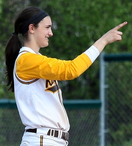 Meg Keller, North Farmington, signals to a teammate that there is one out during the North Farmington softball tournament at Farmington Hills Harrison Saturday, May 10, 2014. (Special to The Oakland Press / LARRY McKEE)