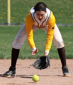 Meg Keller, North Farmington, makes a play from her shortstop position during the North Farmington softball tournament at Farmington Hills Harrison Saturday, May 10, 2014. (Special to The Oakland Press / LARRY McKEE)