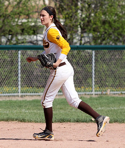 Meg Keller, North Farmington, backs up a play from her shortstop position during the North Farmington softball tournament at Farmington Hills Harrison Saturday, May 10, 2014. (Special to The Oakland Press / LARRY McKEE)