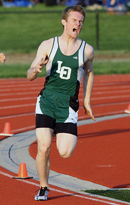 Kirk Hansen, Lake Orion, captured first place in the 800-meter run during Oakland Activities Association varsity track action at Rochester High School Thursday, May 8, 2014. (For the Oakland Press / LARRY McKEE)
